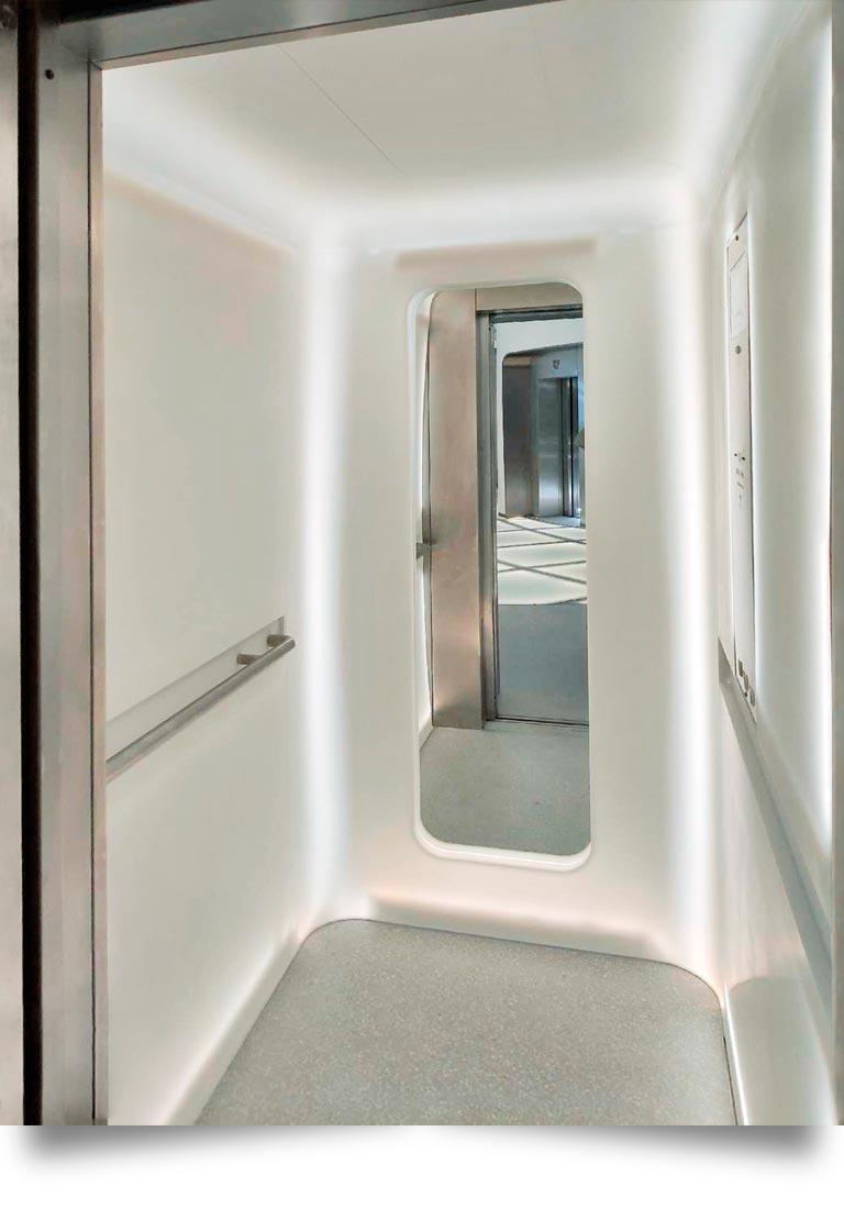 habillage ascenseur pierre acrylique